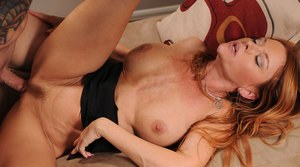 Middle-aged redhead Janet Mason gets banged after giving her lover a kiss