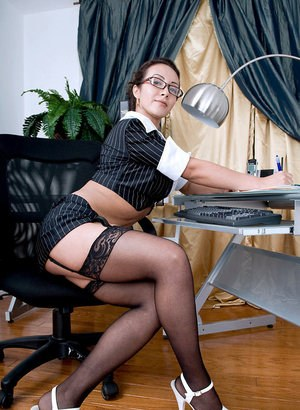 Nerdy Latina lady pleasures her pink pussy in her home office
