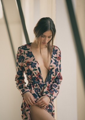 Gorgeous solo model Ilvy Kokomo slips out of her dress for centerfold shoot